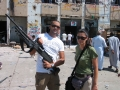 With a freedom fighter at Bab-al-Aziziya, Tripoli, 2011
